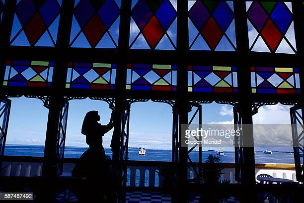 Stainedglass windows and open doors reveal a picturesque view of the Indian Ocean from the Tembu House Hotel on Zanzibar