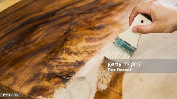 staining wood with paintbrush - チーク ストックフォトと画像