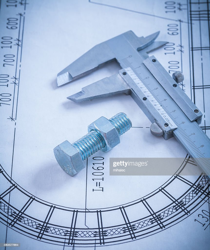 Stainless bolt with screw nut roller bearings on blueprint const : Stock Photo