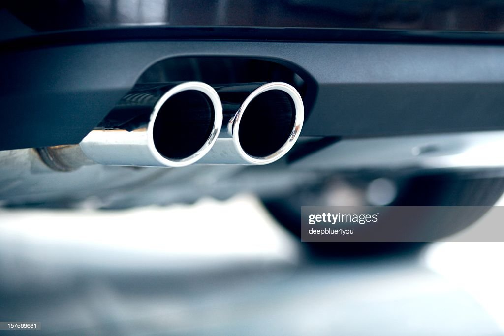 Stainless steel exhaust pipes on a blue car : Stock Photo