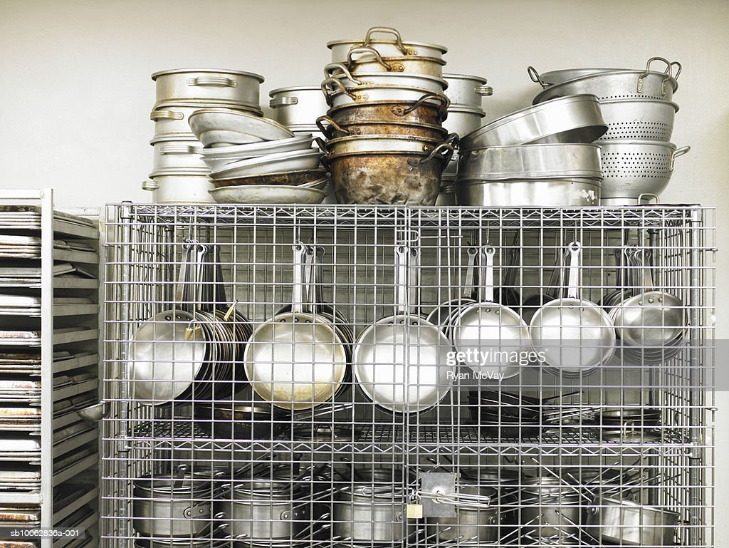 Stainless steel pots and pan in commercial kitchen : Stock Photo