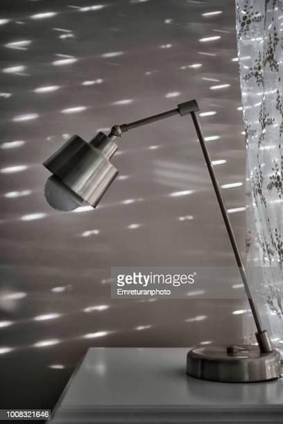 stainless steel reading lamp. - emreturanphoto stock-fotos und bilder