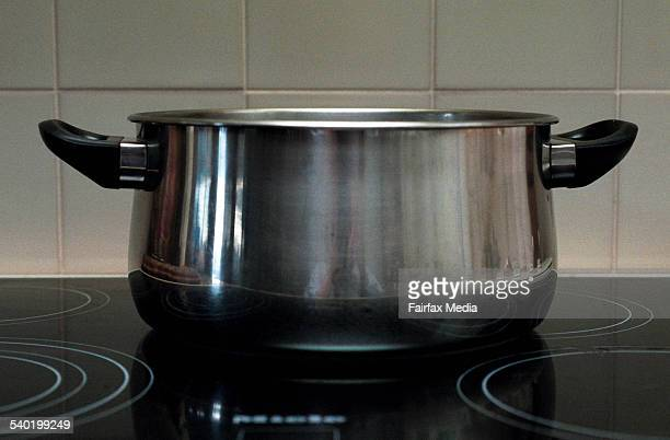 Stainless steel saucepan on a ceramic cooktop in a kitchen