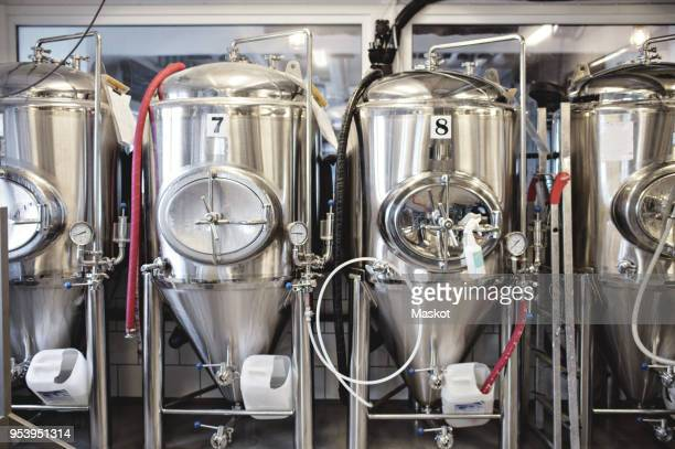 stainless steel storage tanks at brewery - storage tank stock photos and pictures