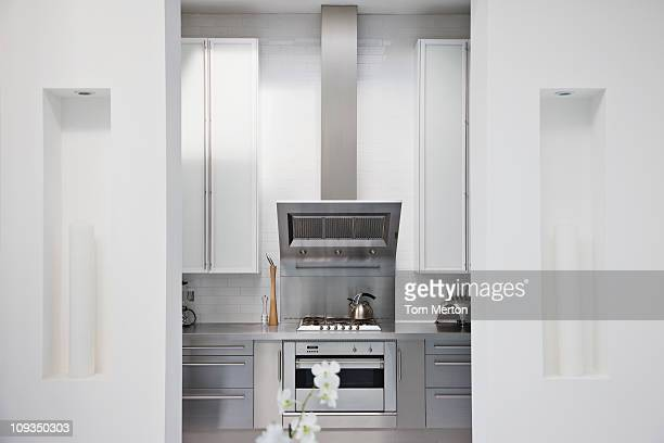 Stainless steel stove in modern white kitchen
