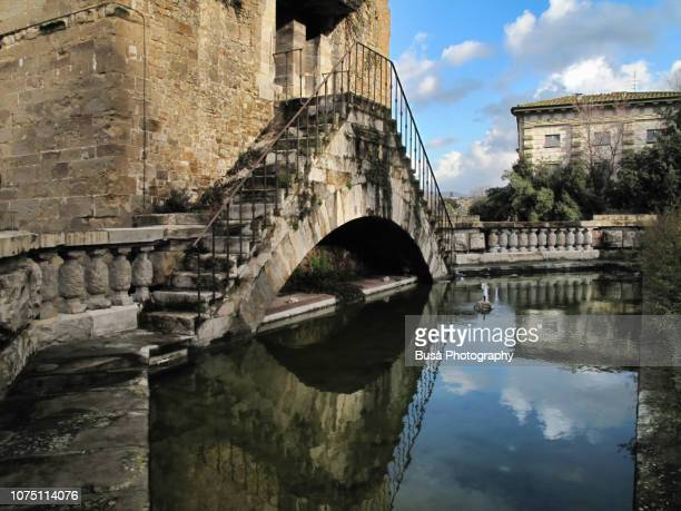Staircase above water pond at Torre San Niccolò (Tower of San Niccolo) in the streets of Florence, Italy