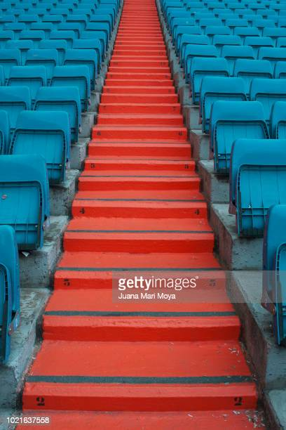 staircase and seats in a football stadium, form a symmetrical composition. - construction material stock pictures, royalty-free photos & images