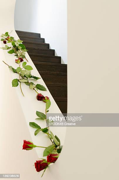 Staircase decorated with red roses