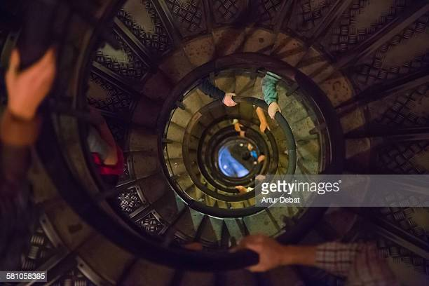 Staircase eye with snail shape and people.
