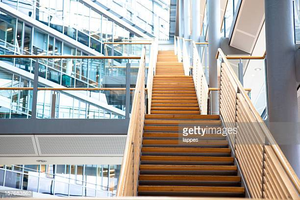 a staircase in a modern office building - man made structure stock pictures, royalty-free photos & images