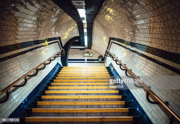 staircase inside underground station - steps stock photos and pictures