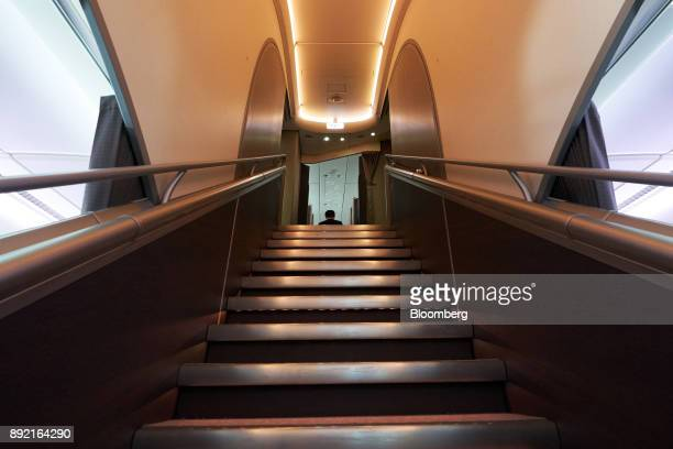 A staircase leads to business class seats and suites inside a Singapore Airlines Ltd Airbus SE A380 aircraft with refitted cabins during a media tour...