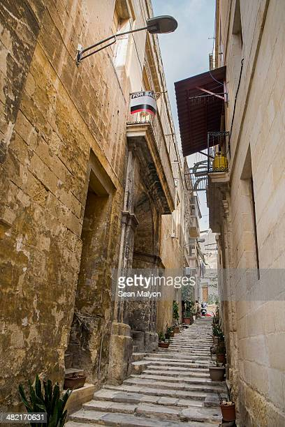 Staircase of typical narrow hilly street, Vittoriosa, Malta
