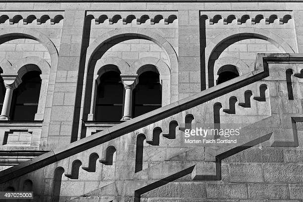 Staircase protected by stone rails, as well as stone windows, at Neuschwanstein Castle in Fussen