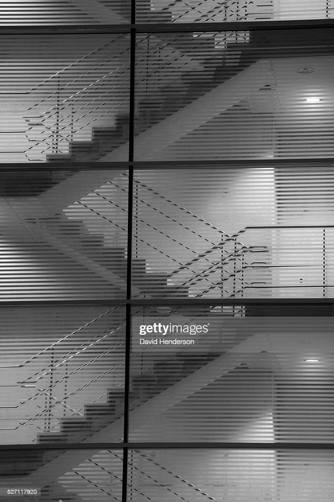 Staircase through a glass wall : Stock Photo