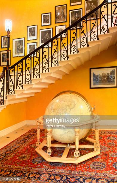 Staircase, with Margaret Thatcher's Globe of 10 Downing Street during December 2013 in London,England.