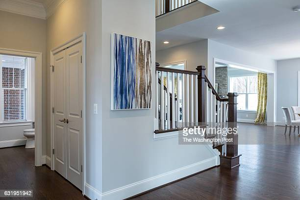 Staircase with Powder Room behind it in the McKinley Model at Indian Springs Farm on January 12 2017 in Lorton Virginia