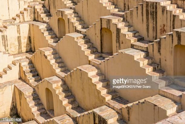 staircases of panna meena ka kund stepwell, amber near jaipur, rajasthan, india - stepwell bildbanksfoton och bilder