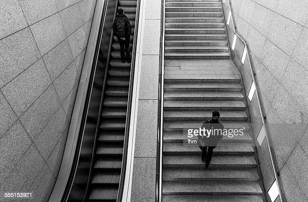 Staircse and escalator with two people