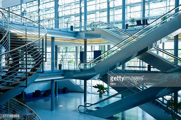 stairs and escalators in modern office building - consumentisme stockfoto's en -beelden
