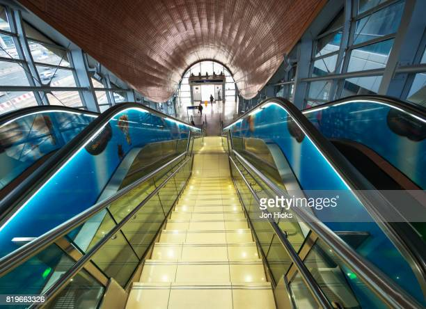 stairs and escalators inside a dubai metro entrance pod. - underground station stock pictures, royalty-free photos & images