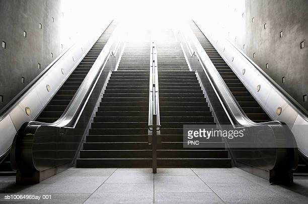 stairs and escalators with bright sunlight on top - escalator stock pictures, royalty-free photos & images