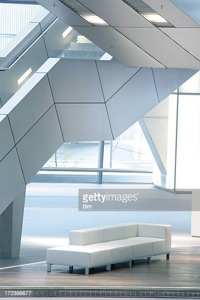 Stairs in Modern Interior, Illuminated Staircase and Sofa