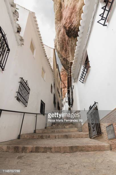 stairs in street of setenil de las bodegas. white village of cadiz, andalusia (spain) - setenil de las bodegas stock-fotos und bilder