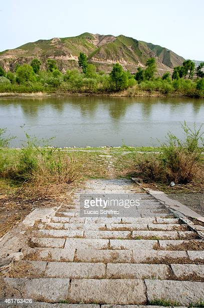 Stairs lead to the Tumen river and North Korea in the background at the ChineseNorth Korean border on May 8 2009 in Tumen Jilin province China On May...