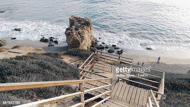 stairs leading to calm shore - malibu stock pictures, royalty-free photos & images