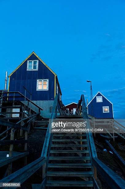 Stairs leading to cottages in an arctic village at night. Kangaamiut, Gammel Sukkertoppen, Qeqqata Municipality, Greenland.