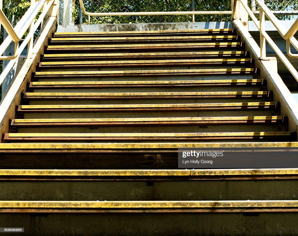 Stairs leading upwards to bridge : Stock Photo