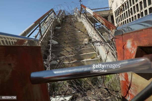 Stairway covered in barbed wire leads to the former visitor's restaurant and terrace at former Nicosia International Airport inside the buffer zone...