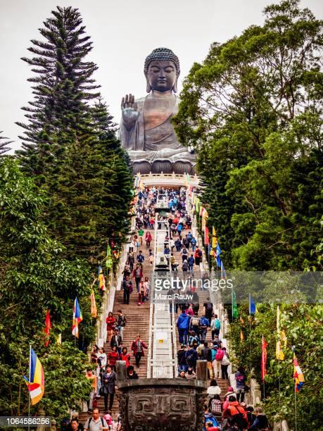 stairway leading to the big buddha statue at ngong ping, lantau island, hong kong. - lantau stock pictures, royalty-free photos & images