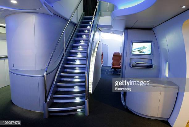 A stairway to the upper cabin of the Boeing Co 7478 Intercontinental jumbo jet is shown in a mockup of the interior at the Boeing Customer Experience...