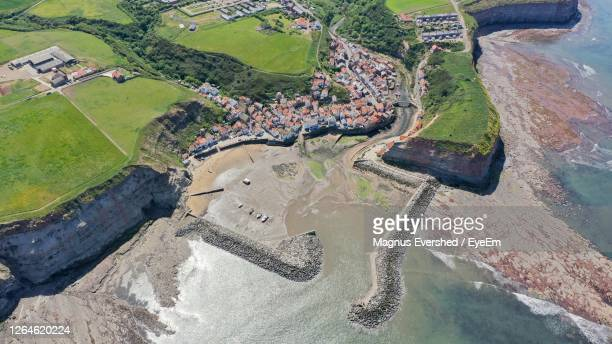 staithes harbour entrance and village from above - coastal feature stock pictures, royalty-free photos & images