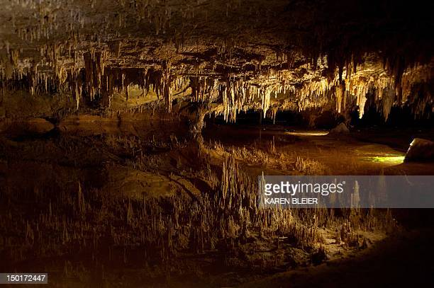 Stalactites reflect on an underground pond water making them seem like stalagmites in an eerie scene on August 11 2012 in Luray Caverns in Luray...