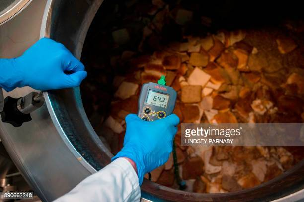Stale bread is seen in a giant kettle as temperature settings are checking during the process of brewing Toast Ale from stale bread barley and hops...