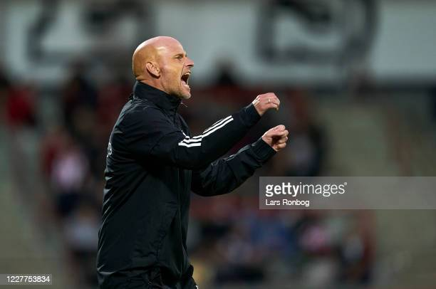 Stale Solbakken, head coach of FC Copenhagen celebrates after scoring their first goal during the Danish 3F Superliga match between AaB Aalborg and...