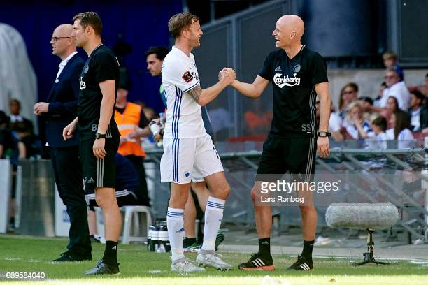 Stale Solbakken head coach of FC Copenhagen shakes hands with Mikael Antonsson of FC Copenhagen during the Danish Alka Superliga match between FC...