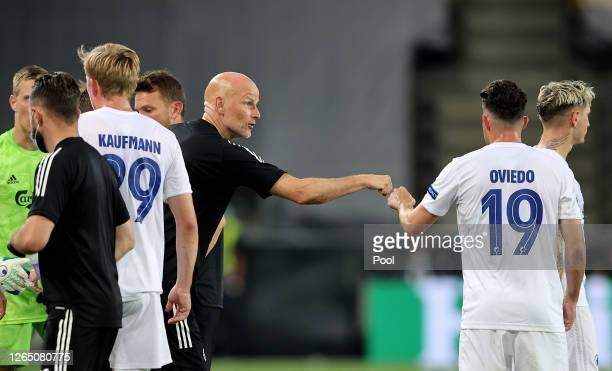 Stale Solbakken, Manager of FC Kobenhavn talks to Bryan Oviedo of FC Kobenhavn during the UEFA Europa League Quarter Final between Manchester United...