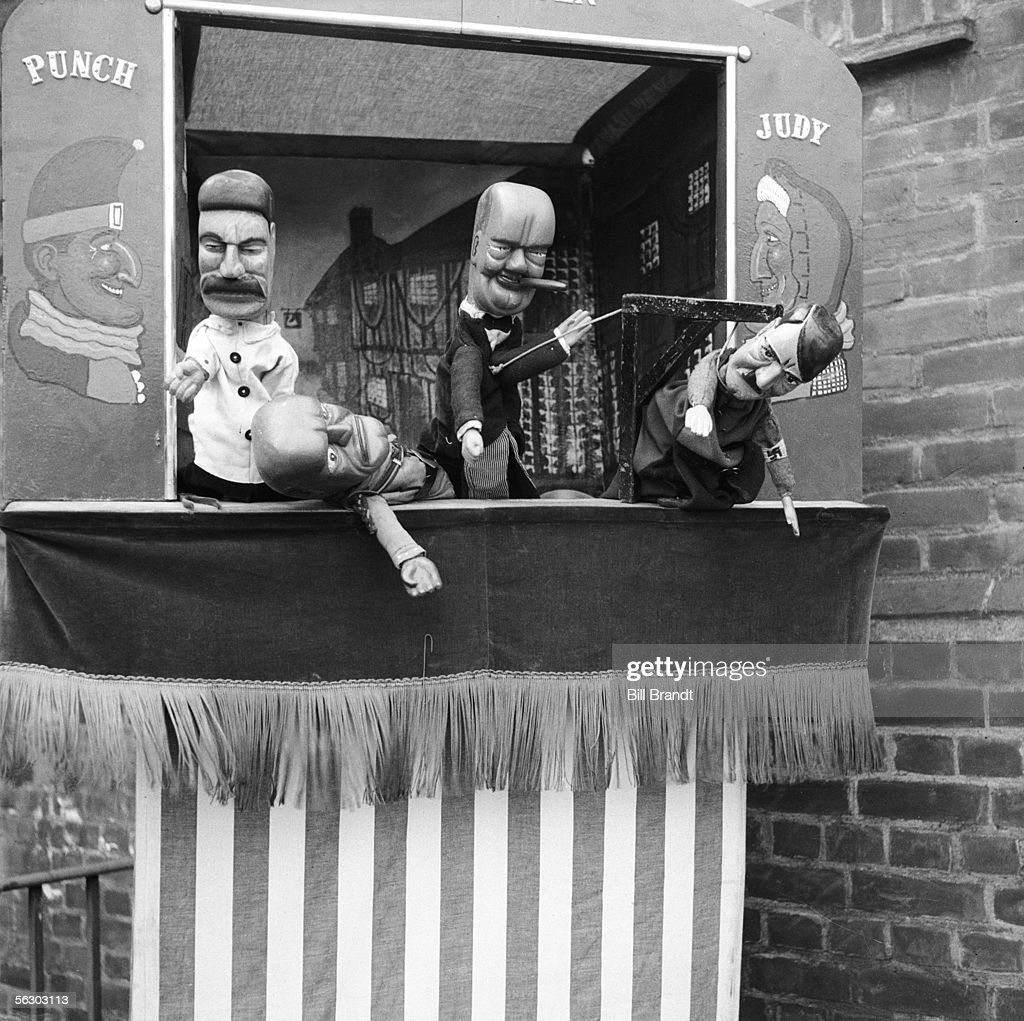 Stalin, Mussolini, Churchill and Hitler are the protagonists in puppeteer Tom Haffenden's topical wartime Punch and Judy show, 23rd August 1941. Original Publication : Picture Post - 837 - What Are All These Children Laughing At? - pub. 1941