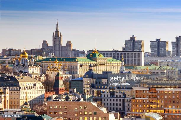 stalinist skyscraper, arbat street buildings and kremlin landmarks of moscow - moscow russia stock pictures, royalty-free photos & images