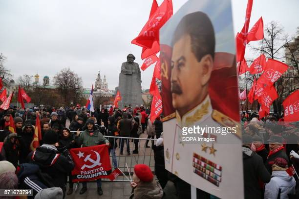 Stalin's portrait seen during the march. Thousands marched to Revolution Square in central Moscow to commemorate the 100th anniversary of the Russian...