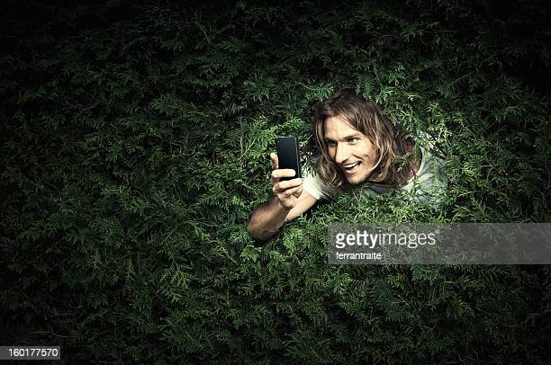 stalker with smart phone - lech stock photos and pictures