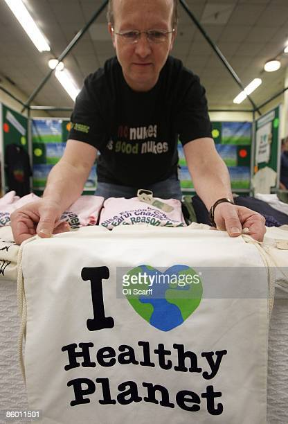 A stall holder arranges a bag with a healthy planet slogan on his stand at UK Aware the UK's only green lifestyle exhibition for people wishing to...