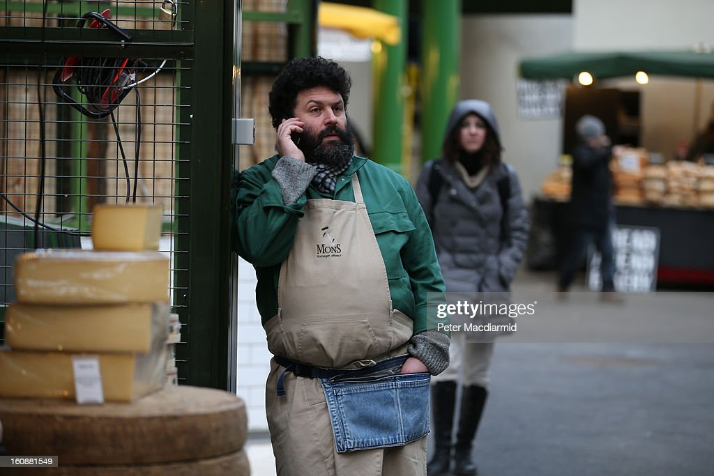 A stall holder makes a phone call at Borough Market on February 7, 2013 in London, England. Borough Market, London's oldest since 1756, has recently completed renovation and today had it's first day of full trading.