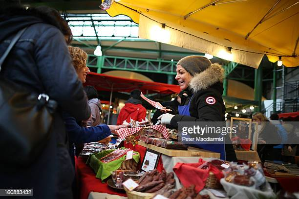 A stall holder makes a sale at Borough Market on February 7 2013 in London England Borough Market London's oldest since 1756 has recently completed...