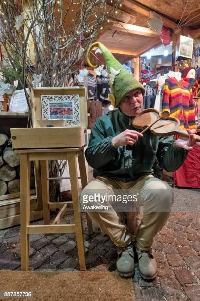 A stall holder plays some music at the 'Basilica' Christmas fair on December 7 2017 in Budapest Hungary The traditional Christmas market and lights...