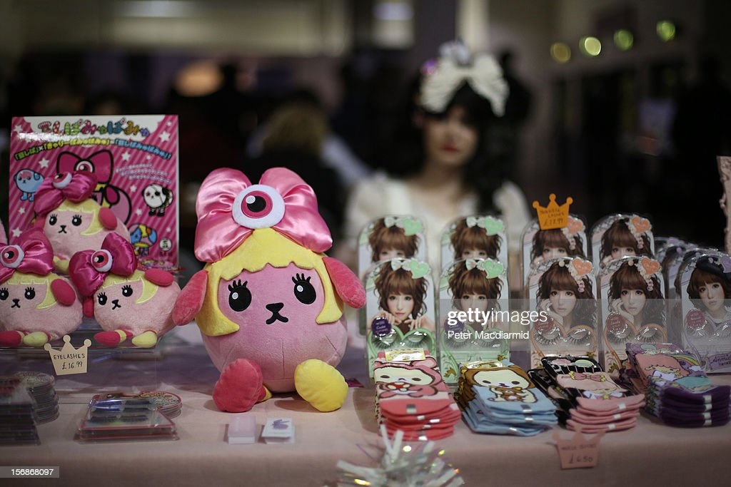 A stall holder sell socks, dolls and fake eyelashes at The Hyper Japan event at Earls Court on November 23, 2012 in London, England. The show is the UK's biggest Japanese Culture event, with stalls selling clothing and artwork. live music, Japanese food and computer gaming areas are also on show. Many attendees dress up as anime characters or in the lolita fashion widespread in Japan.